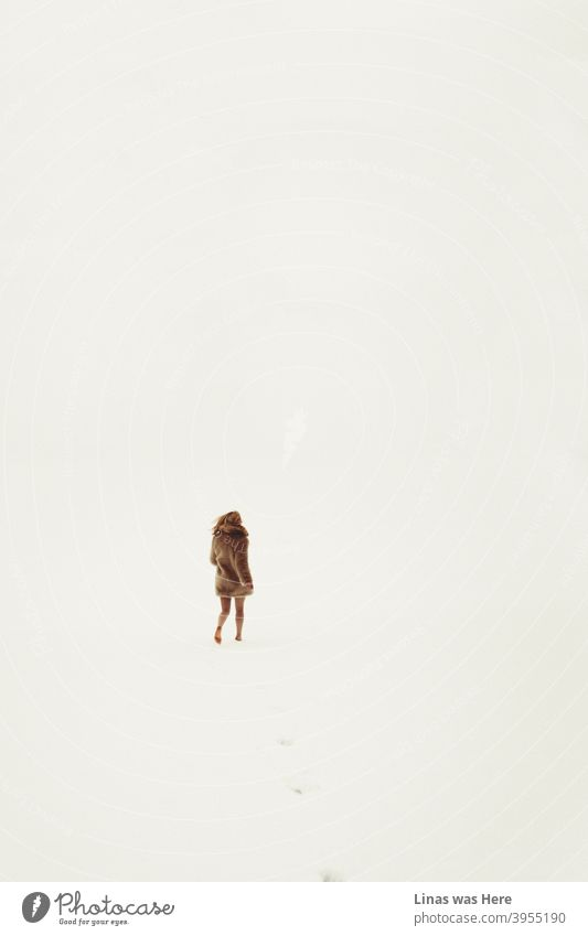 All is white, all is bright. Endless snowy fields are all you can see in the winter horizons. And a barefoot girl running into the wilderness. Dressed in brown fur and with no pants, she is leaving her traces in the cold snow.