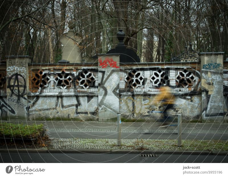 (All nearly) dead cemetery wall Wall (barrier) Cemetery Jewish cemetery Schönhauser Allee Prenzlauer Berg Cycle path cyclist motion blur Mobility Historic
