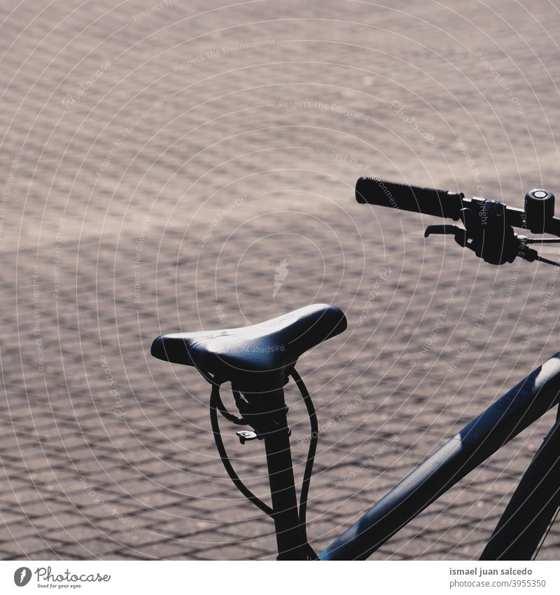 bicycle seat, bicycle mode of transport bike black transportation cycling biking object hobby street outdoors lifestyle