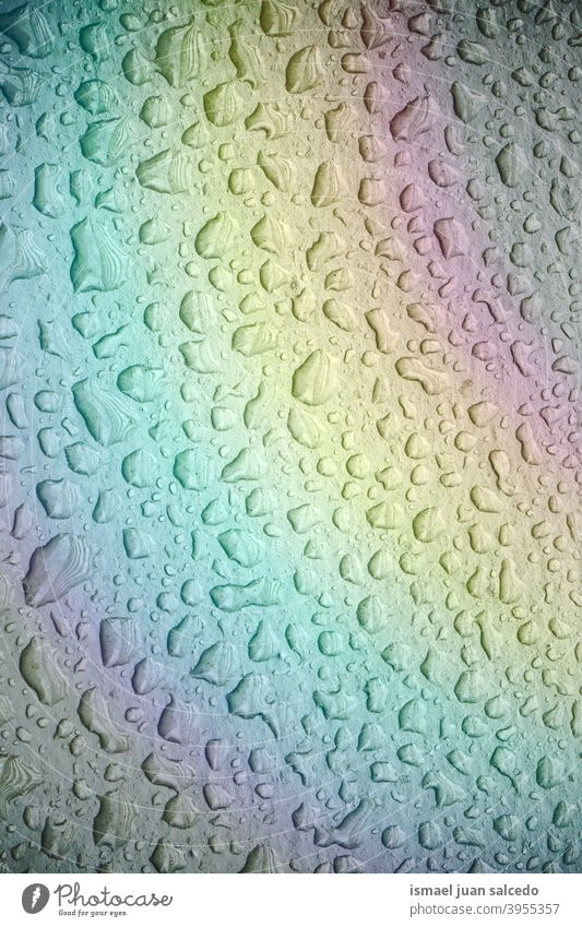 raindrops and rainbow on the metallic surface rainy water wet floor aqua ground abstract background pattern textured colors backgrounds Rainbow Drops of water