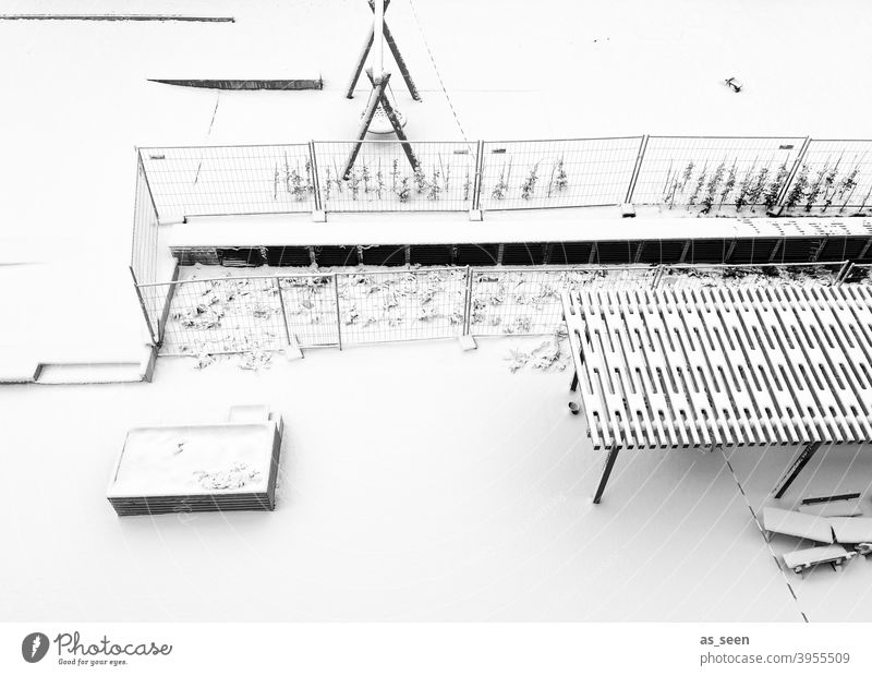 Snowy playground Playground Winter Swing Cold graphically Bird's-eye view Exterior shot Deserted To swing Infancy forsake sb./sth. Day Child Loneliness Calm