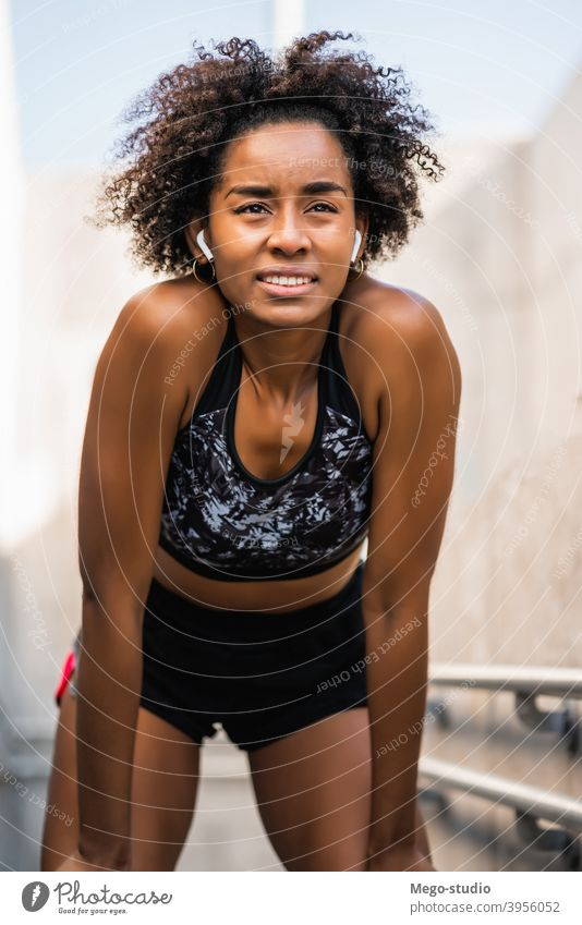 Athlete woman relaxing after work out outdoors. fitness athlete sport exercise resting break enjoying relaxation leisure city sporty sportswoman active health