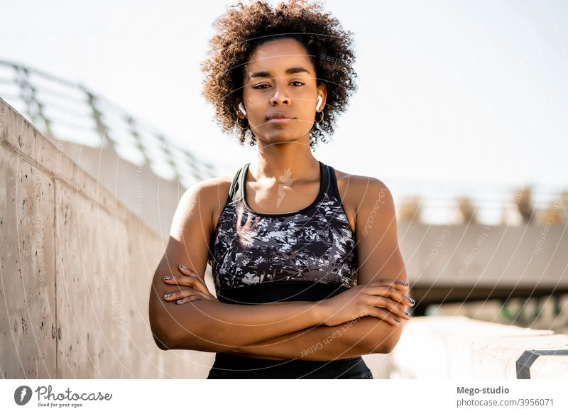 Afro athlete woman standing outdoors. fitness sport exercise resting break relax enjoying relaxation leisure city sporty relaxing sportswoman active health