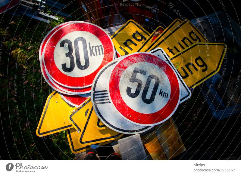 Many traffic signs are lying on top of each other on the ground, speed limit 30 km/h, 50 km/h, diversion Traffic signs Speed limit Diversion Urban transport