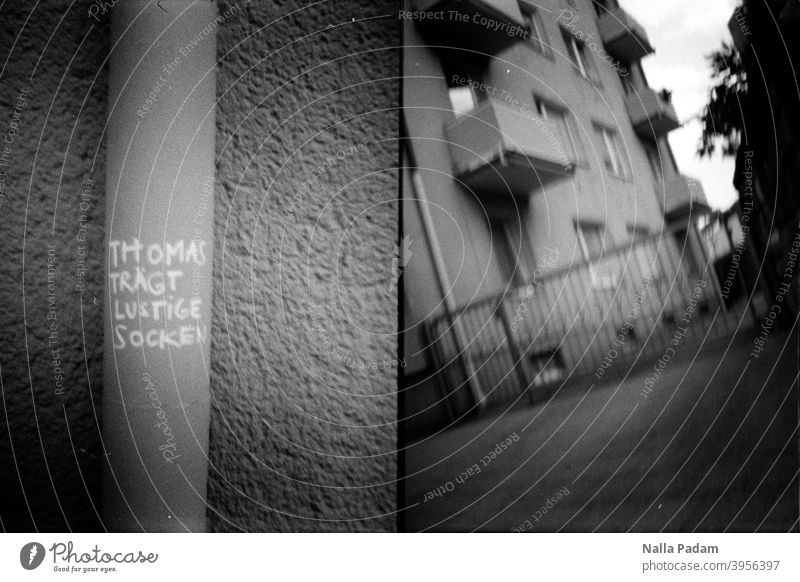 Cityscape Duet 1 Analog Analogue photo black-and-white Downpipe Text graffiti saying Thomas wears funny socks House (Residential Structure) The Ruhr