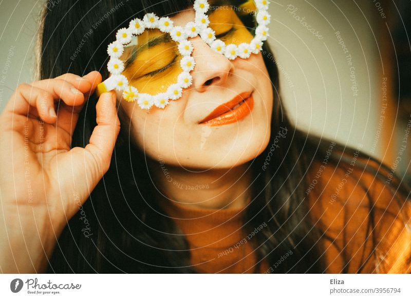 Woman with flower sunglasses in the sunlight. Retro mood, optimism good mood and summer. Sunglasses Optimism summer atmosphere Spring sunshine little flowers