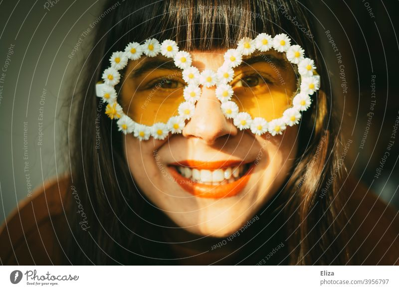 Laughing woman with flower sunglasses in the sunlight. Retro mood, good mood, optimism and summer. Sunglasses summer atmosphere Optimism Woman Spring sunshine