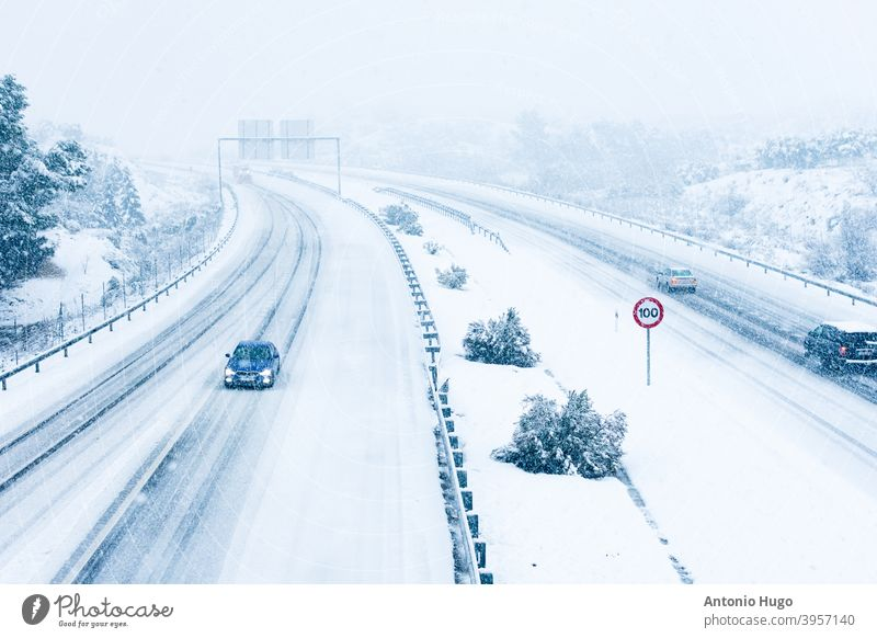 Cars driving on a snowy road. cars highway weather slippery transportation vehicle ice traffic blizzard auto automobile drive white danger snowfall condition