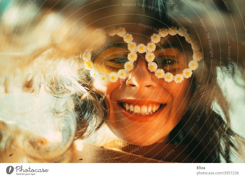Smiling woman in funny flower sunglasses looks at the camera bent forward Woman Sunglasses little flowers Good mood Joy Eyeglasses Hippie leaning over look down