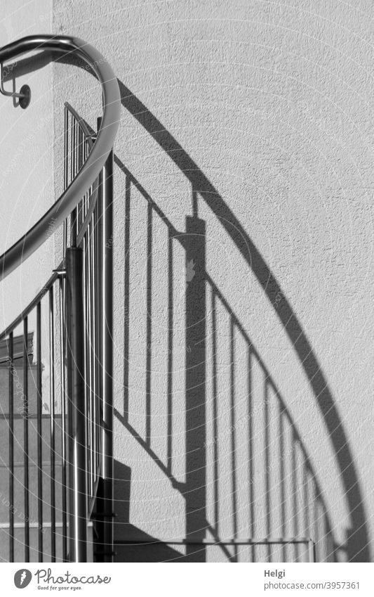 Stair railing with shadow cast on a wall Banister Light Shadow Wall (building) flexed Direct Deserted Exterior shot Building Black White Gray Contrast lines