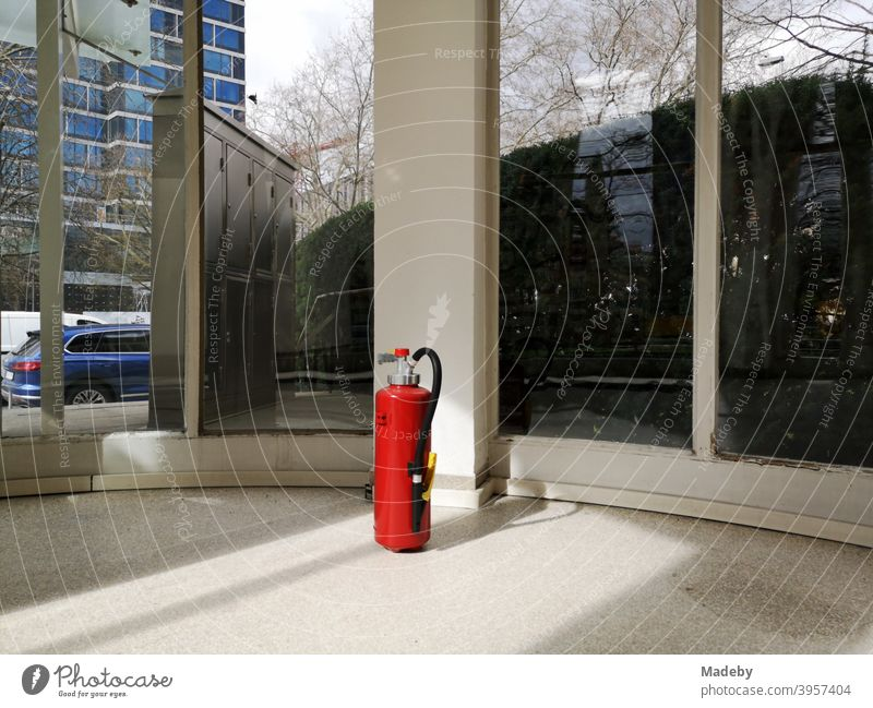 Red fire extinguisher in the foyer of a listed office building from the fifties in the West End of Frankfurt am Main in Hesse Extinguisher bright red Safety
