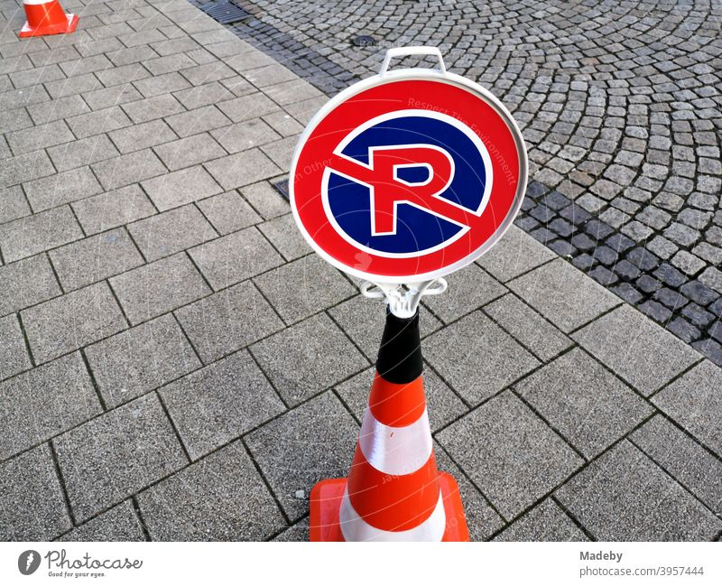 Portable unofficial traffic sign for no parking and no stopping on a Lübeck hat on grey pavement Transport Road sign No Parking No standing Road traffic cordon