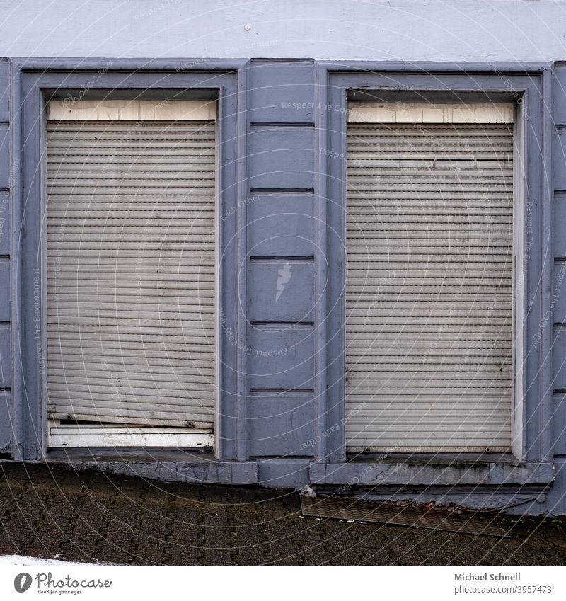 Old grey shutters on an old house roller shutter Gray Blue Closed Window Facade Gloomy Wall (building) Deserted Roller shutter Decline