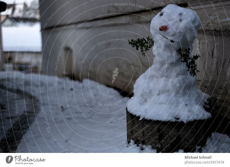 Snowman on a planting ring on a house wall Winter Cold White Exterior shot Playing Frost