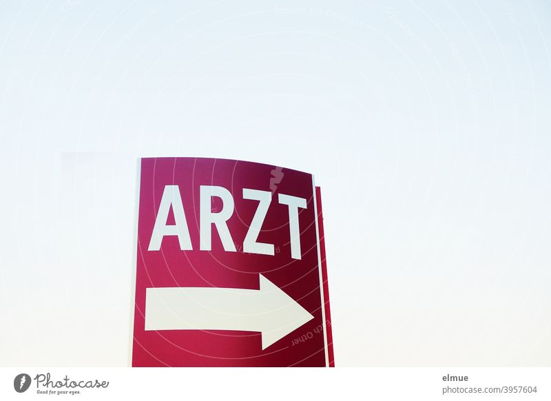 "the wine-red sign says ""ARZT"" in white above a big white arrow / emergency / orientation Clue Signage Doctor label Arrow White Help Signs and labeling"