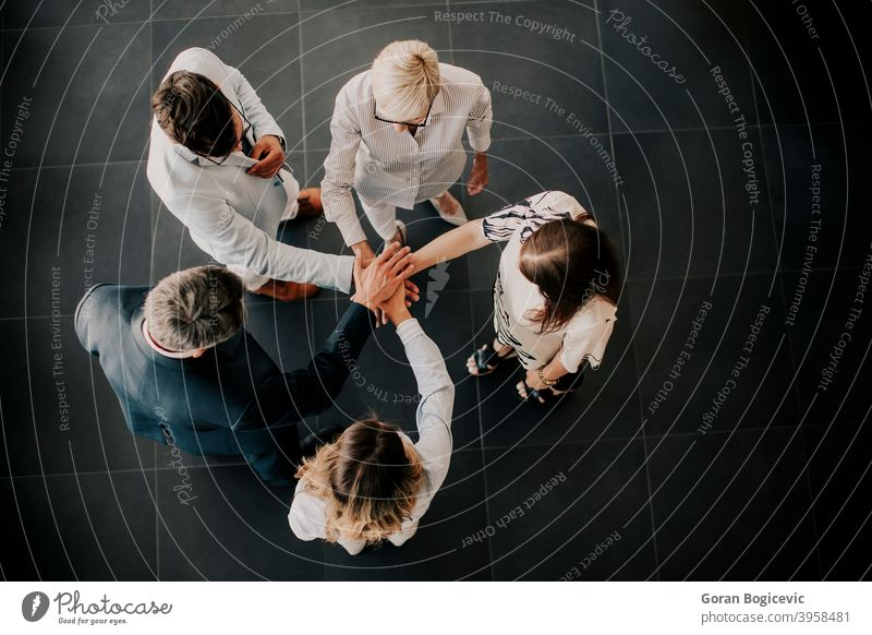 Hands over hands as a team concept agreement background bracelet business closeup collaboration community conceptual connect connection cooperation corporate