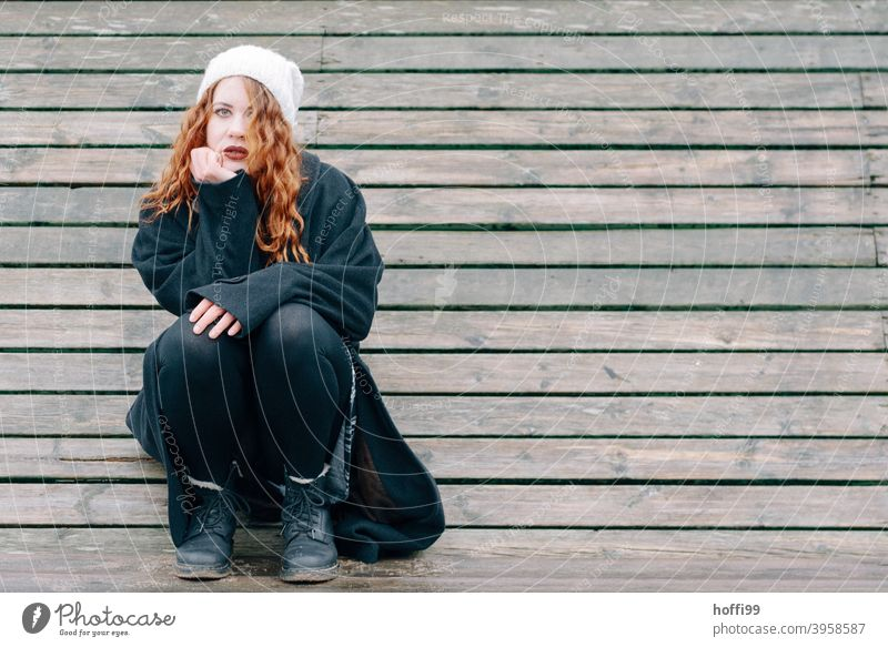 the young woman looks thoughtfully, melancholically into the camera portrait Woman Looking into the camera Red-haired melancholy Face Face of a woman