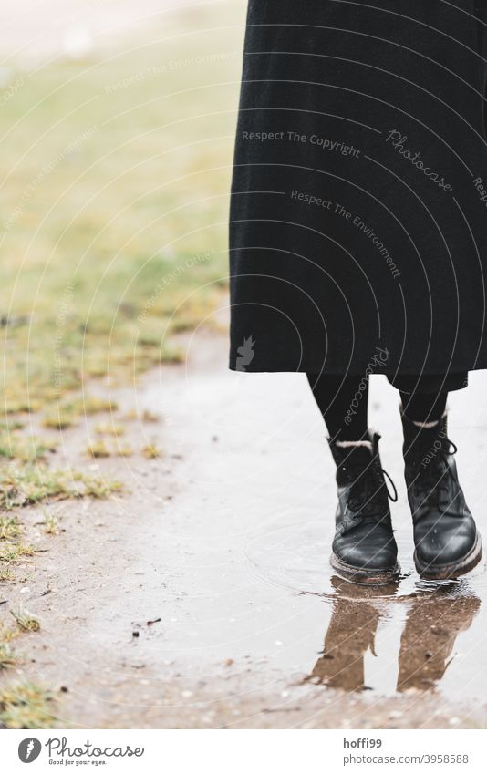 boots in the puddle keep feet dry Boots Footwear Woman Legs Clothing Feminine Stand Puddle puddle mirroring Fashion Adults Feet Youth (Young adults)