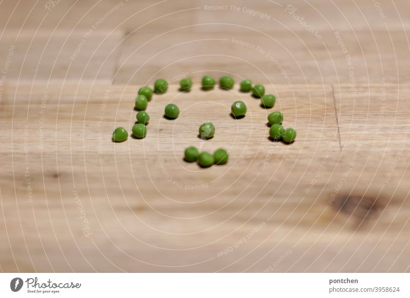 A face formed from peas. Healthy diet Peas salubriously Nutrition legume Vegetarian diet Face symbolism Positive Eating Vegan diet Food photograph Green