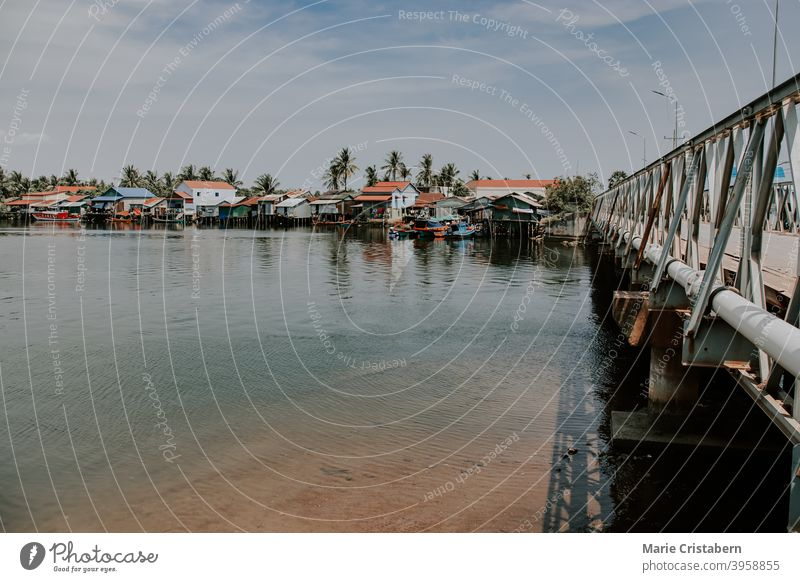Rows of stilted houses on the riverside in Kampot, Cambodia kampot cambodia quaint lifestyle travel photography asia no people copy space rural life