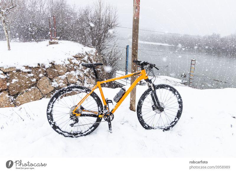 orange mountain bike in snowy landscape sport outdoor nature grass autumn run tree rider walk travel racer biking recreation biker athlete motion cyclist