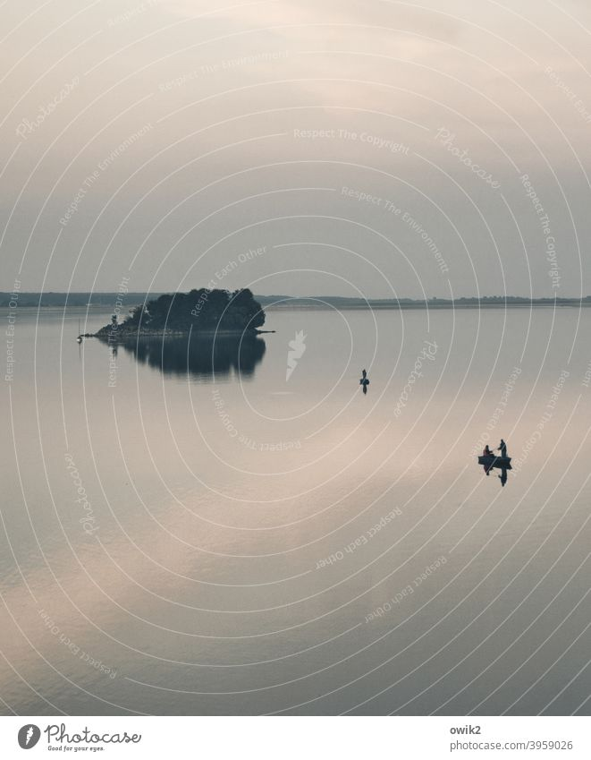 Free floating Reservoir Island Sky Evening Calm Leisure and hobbies Watercraft Far-off places Freedom Surface of water Glittering Long shot Nature Landscape