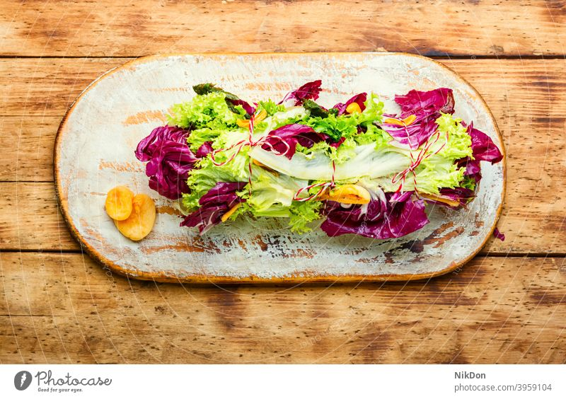 Paupiette from salad and fish paupiette salmon lettuce roll stuffed green food meal vegetable braciole dinner dish healthy lunch appetizer lollo rossa fresh raw