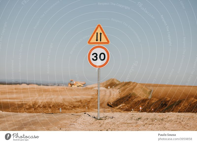 Speed limit sign in construction site Speed control Construction site Sign Transport Traffic infrastructure Street Road sign Exterior shot Road traffic Asphalt