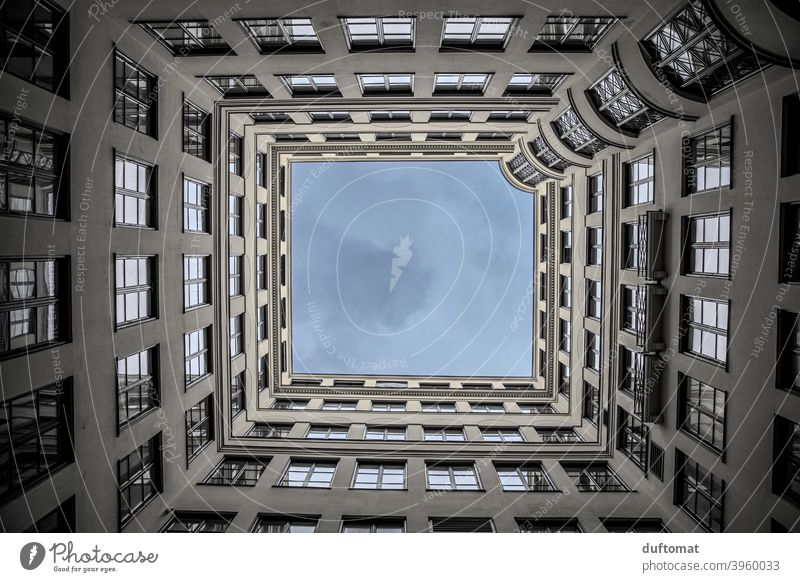 View upwards from the inner courtyard in the housing area Upward Above Clouds houses Häuserkarree Sky Architecture Building Facade Manmade structures Window