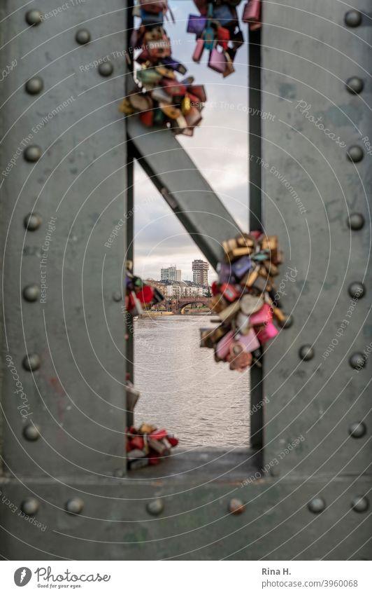 Love locks on Main bridge in Frankfurt with view of the city Love Locks Bridge symbol Vista iron bridge remembrances Steel bridge Stud Portrait format