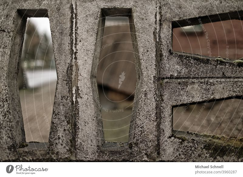 View through a wall Wall (barrier) Building stone Exterior shot Colour photo Deserted Stone Subdued colour Vista see through Forms and structures