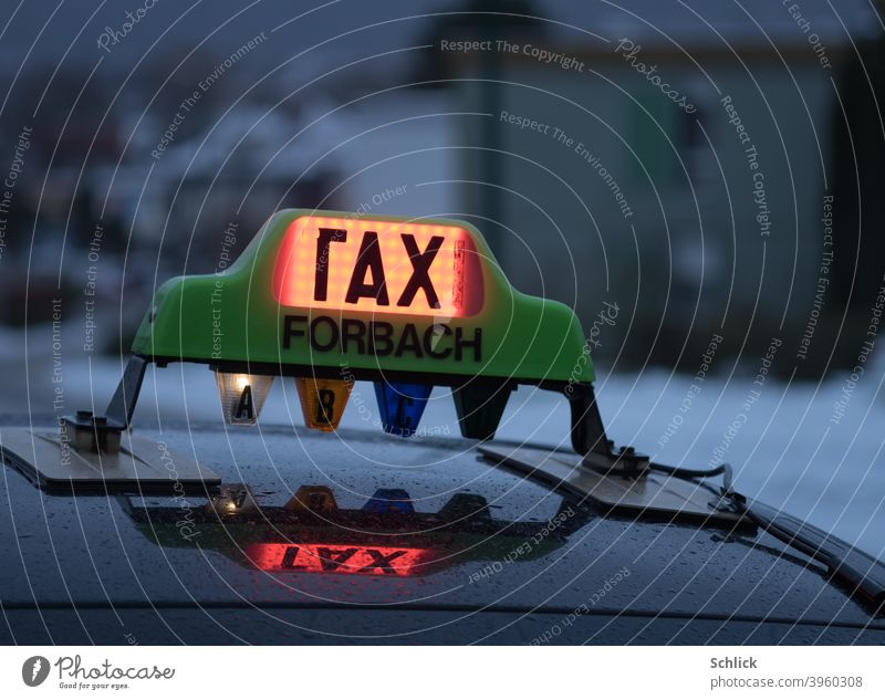 Defective light on a taxi from Forbach Lorraine with inscription rax and reflection in the rain wet tin roof taxi sign Taxi Rainy weather broken Text Covered