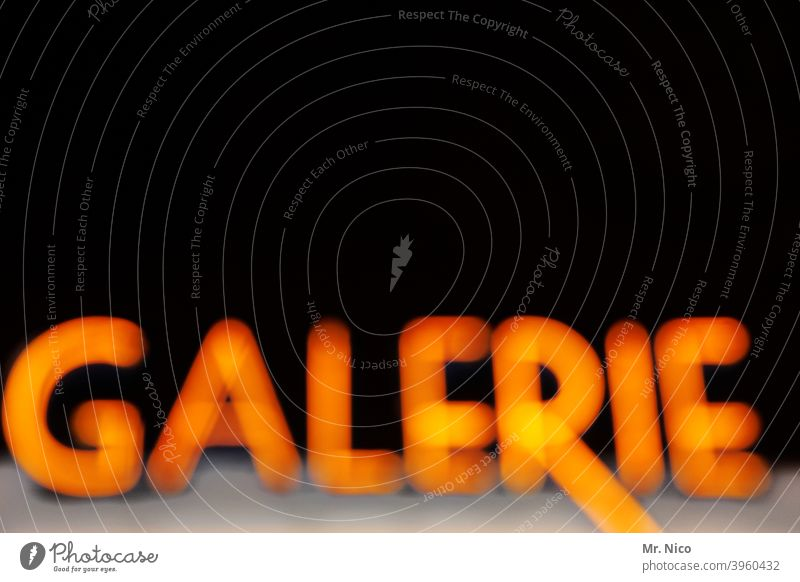 gallery Characters Art gallery Design Style Black Typography Neon sign Signs and labeling Letters (alphabet) Culture Museum Neon light Theatre Night blurriness