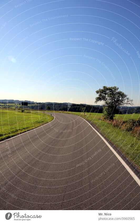 highway Country road Lanes & trails Traffic infrastructure Street Asphalt Environment Curve Landscape Field Sky Tree Nature Meadow Beautiful weather Hill