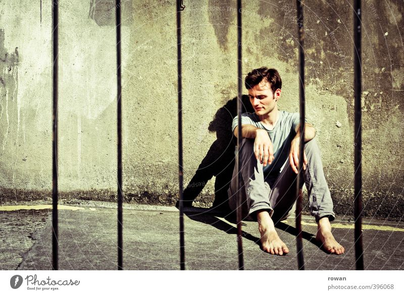 I'm behind bars. Human being Masculine Young man Youth (Young adults) Man Adults 1 Wall (barrier) Wall (building) Threat Dark Creepy Cold Broken Gloomy