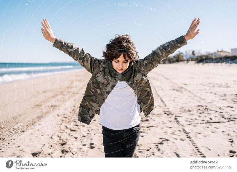 Portrait of boy walking on the beach in winter child mediterranean sea mediterranean culture authentic active break children coast cold concept enjoy family fun