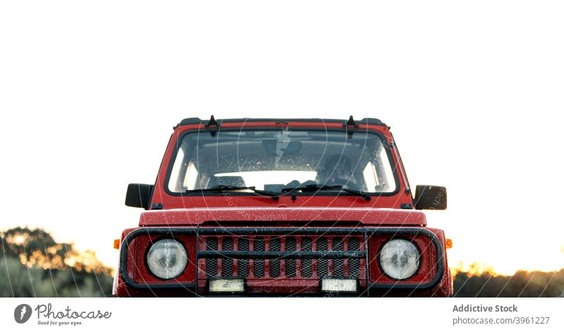 SUV automobile parked on rural road man car off road suv drive adventure nature journey travel vehicle forest red power motor summer countryside trip path way