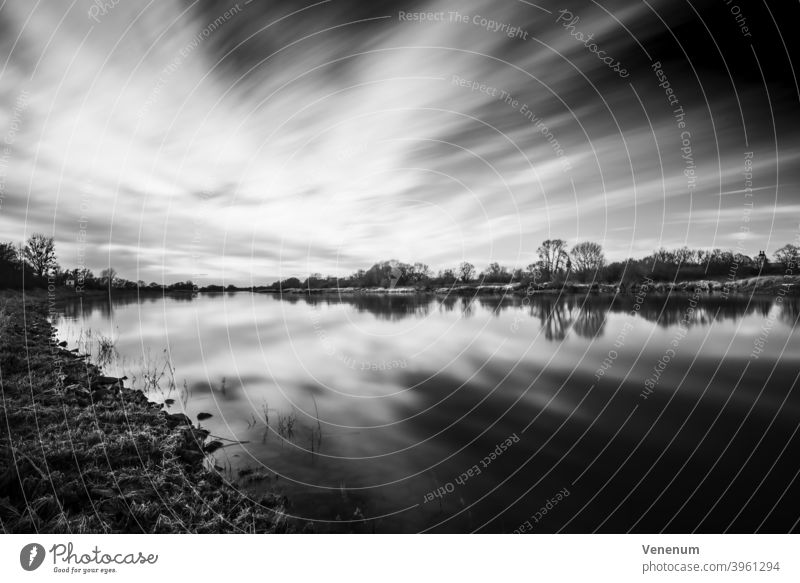 Long exposure with view over the Elbe Elbe Landscape black on white River Water Lutherstadt Wittenberg Views of the river river landscape Clouds Heaven