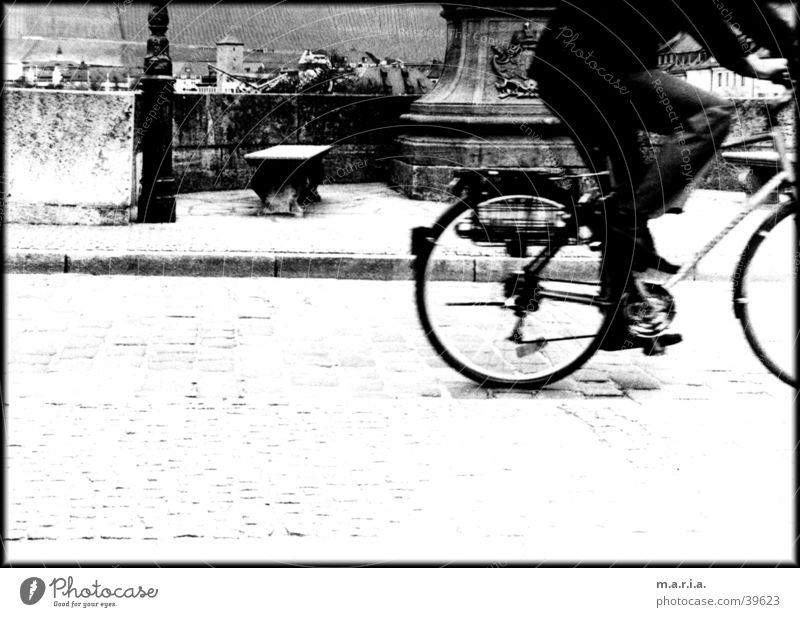 cyclists Bicycle Speed Motion blur Sidewalk Town Würzburg Transport Black & white photo Street Cobblestones Bridge Bench