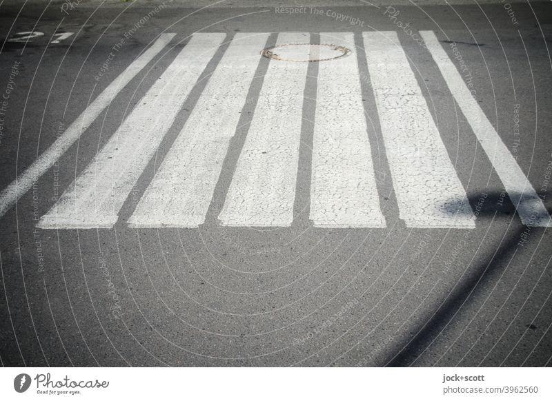 A zebra crossing between 21 and the street lights Street Zebra crossing Calm Structures and shapes Asphalt Symmetry Under Stripe Lane markings Arrangement Gully