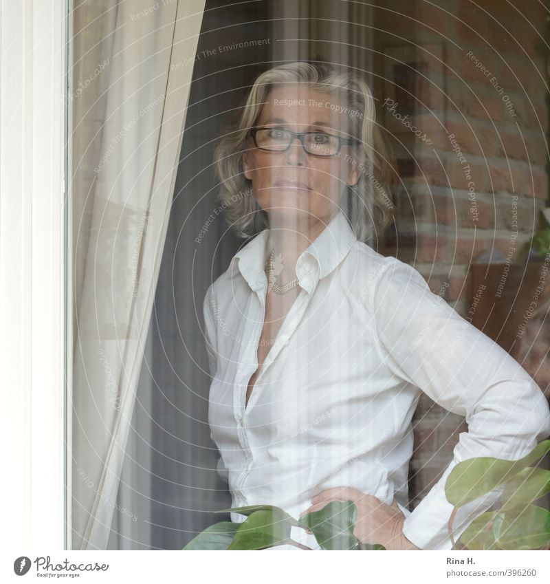 Good times, bad times Curtain Human being Woman Adults 45 - 60 years Window Blouse Eyeglasses Blonde White-haired Authentic Feminine Emotions Earnest Easygoing