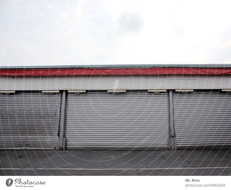 warehouse Goal Storage Warehouse Depot Wholesale market Building Trade Entrance Gloomy Closed Rolling door Stock of merchandise Garage Garage door come down