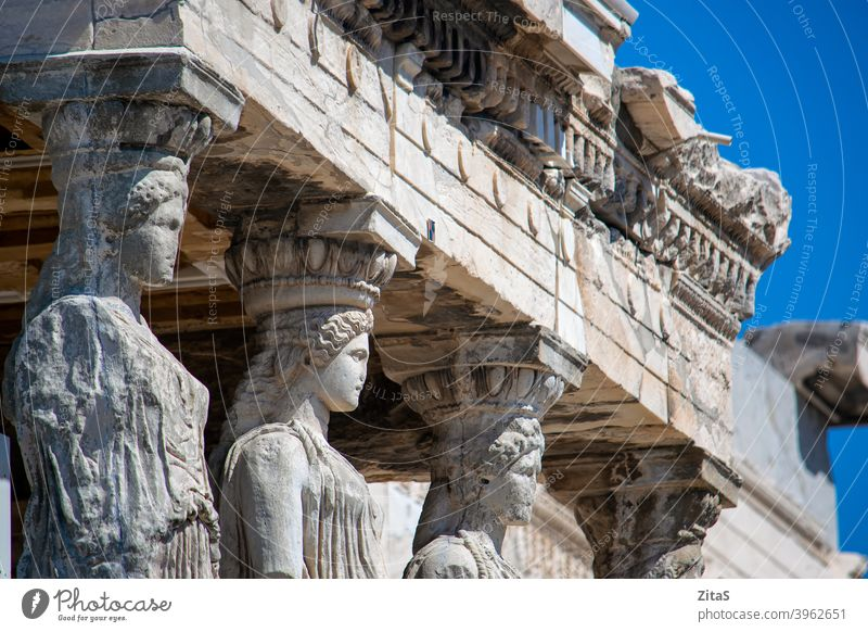 Closeup of Caryatids from Erechthion temple at Acropolis acropolis greece athens caryatids statue statues ancient old building exterior erechthion greek history