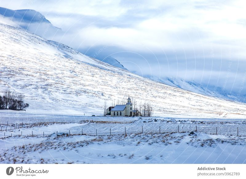Church in mountains in winter church highland landscape building lonely snow valley scenery iceland scenic sunny frost range nature season rock cold weather