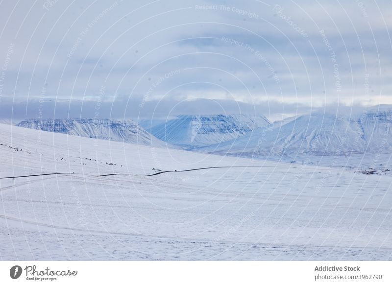 Curved road in mountains in winter curve snow roadway highland empty winding valley iceland landscape asphalt route scenic nature terrain environment weather