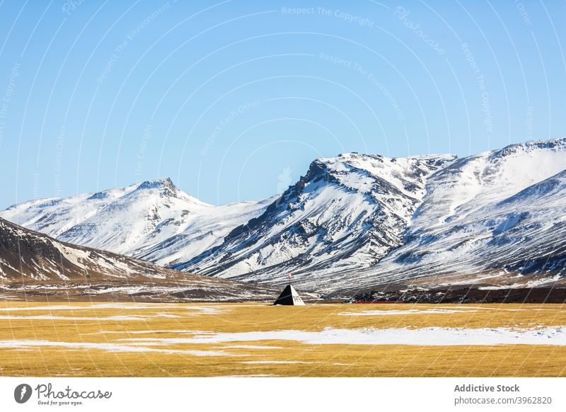 Wigwam in mountainous valley in winter wigwam landscape highland snow sunny construction residential iceland cold picturesque spectacular idyllic amazing scenic