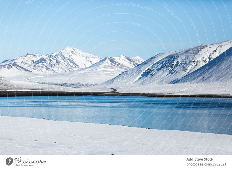 Lake in mountainous terrain in winter lake landscape pond highland sky blue snow white iceland majestic scenery scenic season calm tranquil environment water