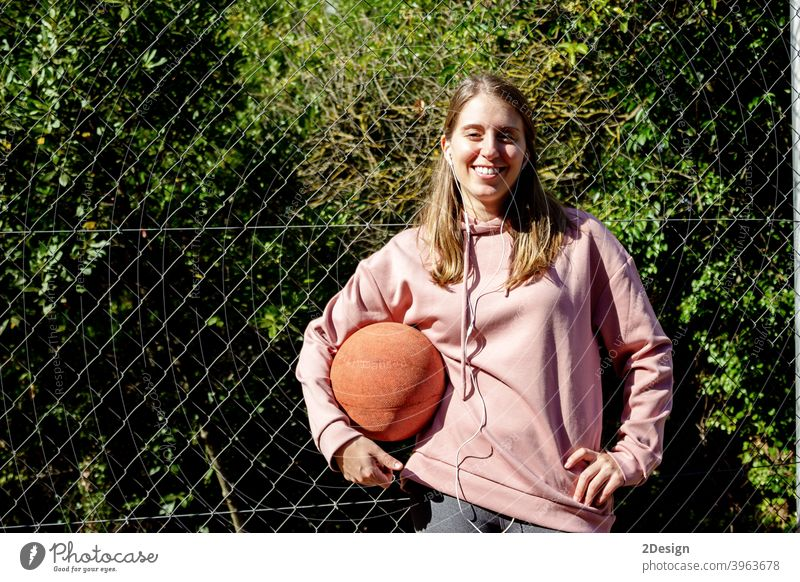 young long haired woman holding a basket ball sport person basketball fitness training athlete female girl player exercise healthy lifestyle game body happy