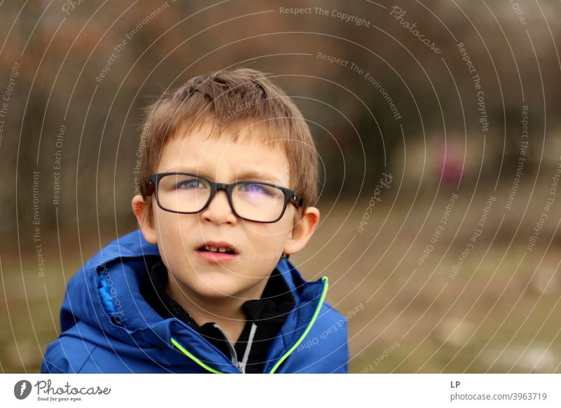 portrait of a boy wearing glasses Copy Space right Exterior shot Multicoloured Looking Problem solving Creativity Complex Inspiration Innovative Hope Interest