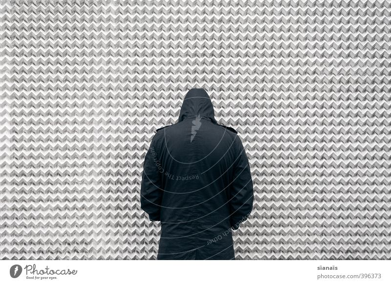 Man pisses on the wall Human being Masculine Adults 1 Manmade structures Building Architecture Wall (barrier) Wall (building) Facade Jacket Coat Stand